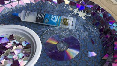 Photo of با تکه های سی دی و DVD وسایل قدیمی را تزیین کنید