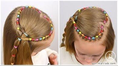 Photo of شنیون موی کودک با طرح قلبی و کش های رنگی