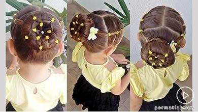 Photo of شینیون مجلسی موی کودک با طرح گل و تزیین کش های رنگی
