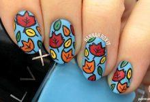 Photo of طراحی روی ناخن آبی به شکل برگهای پاییزی